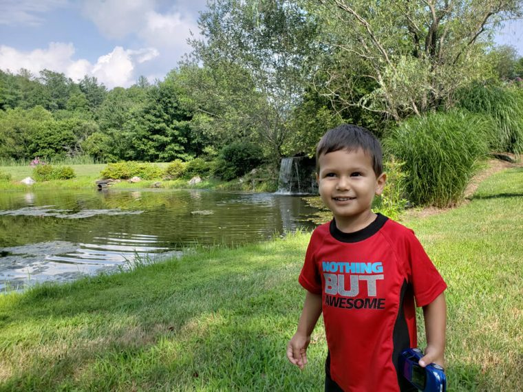 Solomon caught by surprise because he was going to jump in the pond