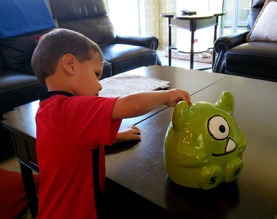 Solomon has an Archie Piggy Bank (OptinMonster Mascot)