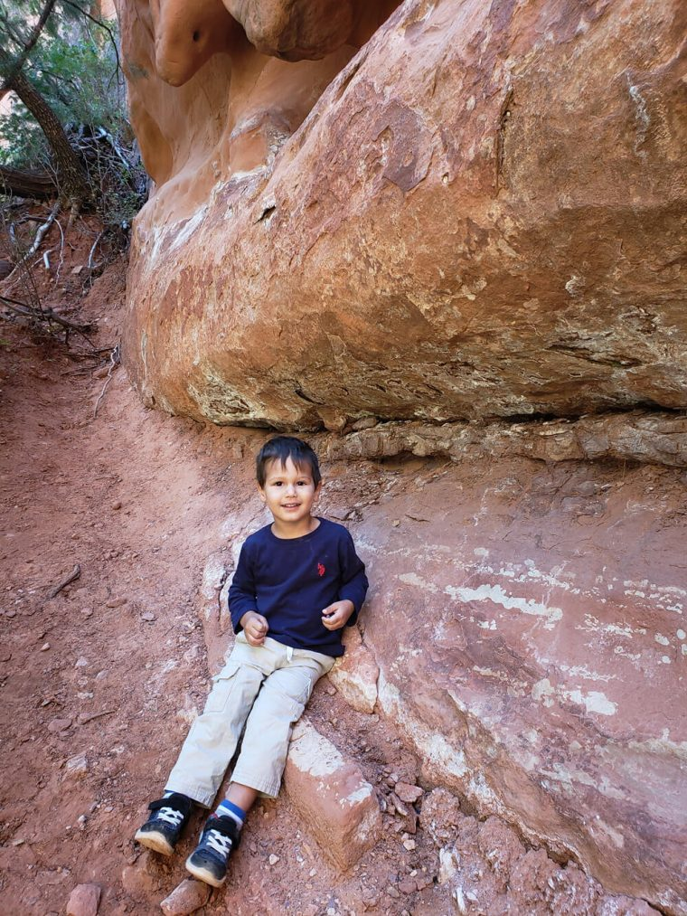 Solomon climbed a rock during a hike at Zion National Park