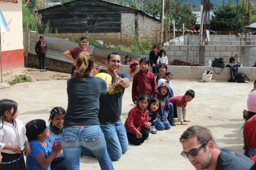 Syed Playing with kids in school that we built in Guatemala with Pencils of Promise.