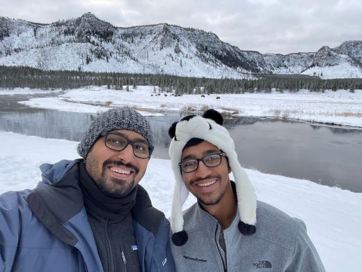 Fun photo with Zain at Yellowstone - Bison herd in background