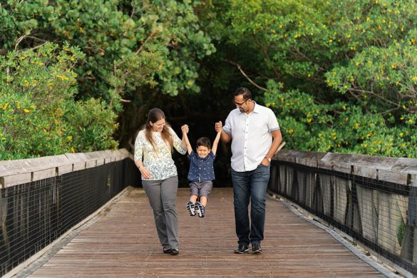 Family photo shoot swinging Solomon
