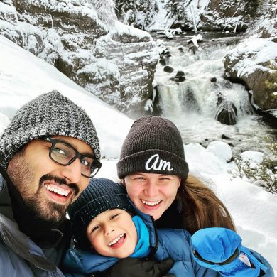 Family selfie at a Yellowstone waterfall